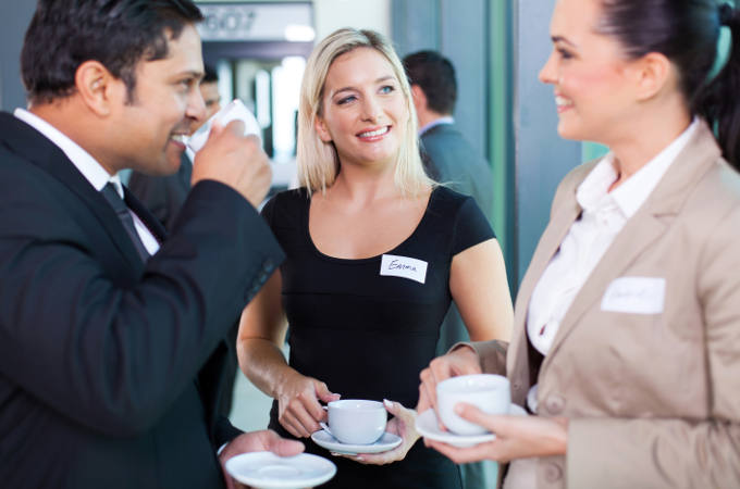 Business people having a coffee break during a seminar