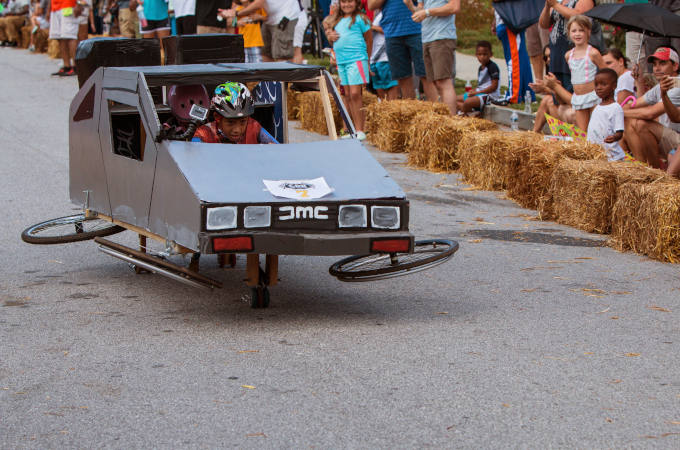 Kid Steers Delorean Mockup In Atlanta Soap Box Derby Event