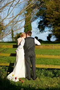 bride and groom - in back of garden